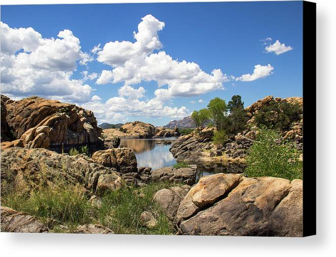 Landscape Canvas Print featuring the photograph Rocky Shore And Pristine Water by Amy Sorvillo