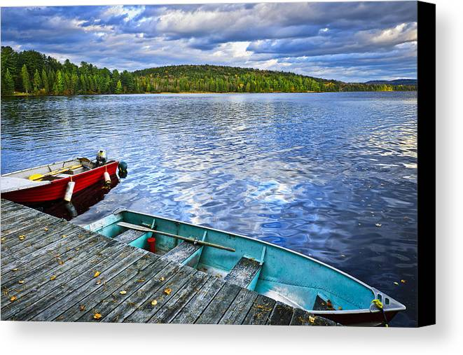 Rowboats Canvas Print featuring the photograph Rowboats On Lake At Dusk by Elena Elisseeva