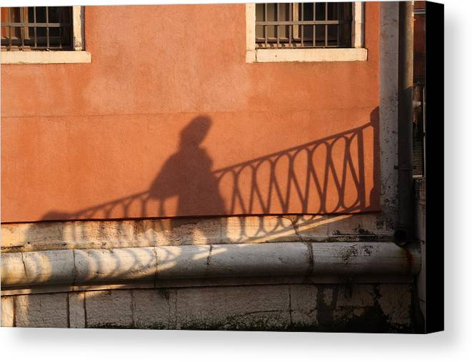 Venice Canvas Print featuring the photograph Shadow Of A Person Crossing The Shadow Of A Bridge In Venice by Michael Henderson