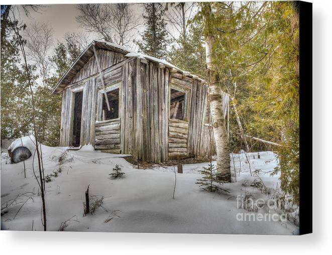 Cabin Canvas Print featuring the photograph Snow Covered Abandon Cabin by Patrick Shupert