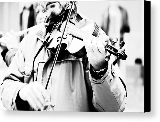 Playing; Man; Violin; Instrument; Musical; Music; Classical; Harmony; Melody; Antique; Symphony; Play; Instrumental; Performance; Musician; Art; Artistic; Violinist; Performing; Black; White; Person; Black And White; Bw; Photograph Canvas Print featuring the photograph Sounds Of A Stranger by Gabriela Insuratelu