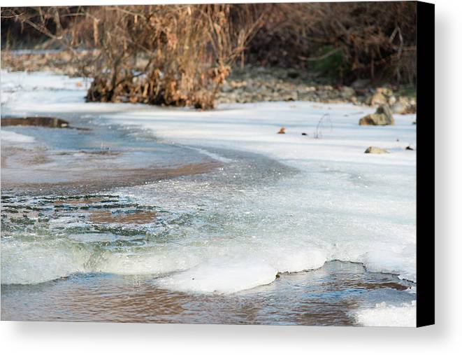 Spring Canvas Print featuring the photograph Spring Is Coming. The Ice Melts. by Nicola Simeoni