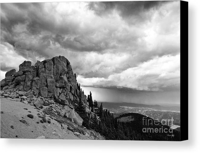 Mountain Canvas Print featuring the photograph Standing Against The Storm by Scott Pellegrin