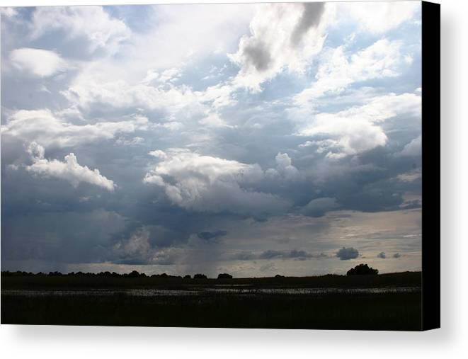 Botswana Canvas Print featuring the photograph Storm Clouds by Linda Russell