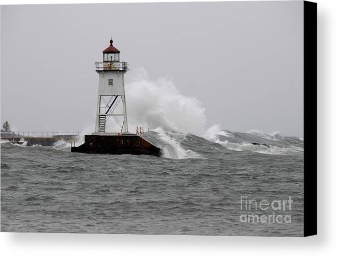 Light House Canvas Print featuring the photograph Storming The Wall by Sandra Updyke