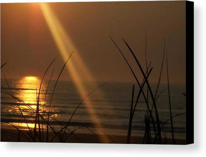 Outer Banks Canvas Print featuring the photograph Sunrise Over The Atlantic by James and Vickie Rankin