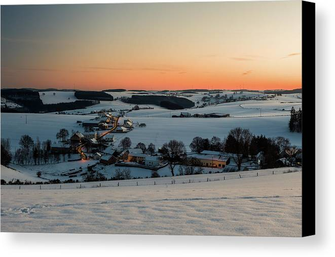 Cold Temperature Canvas Print featuring the photograph Sunset Over Winter Landscape by Manuel Posch