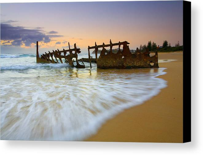 Shipwreck Canvas Print featuring the photograph Swallowed By The Tides by Mike Dawson