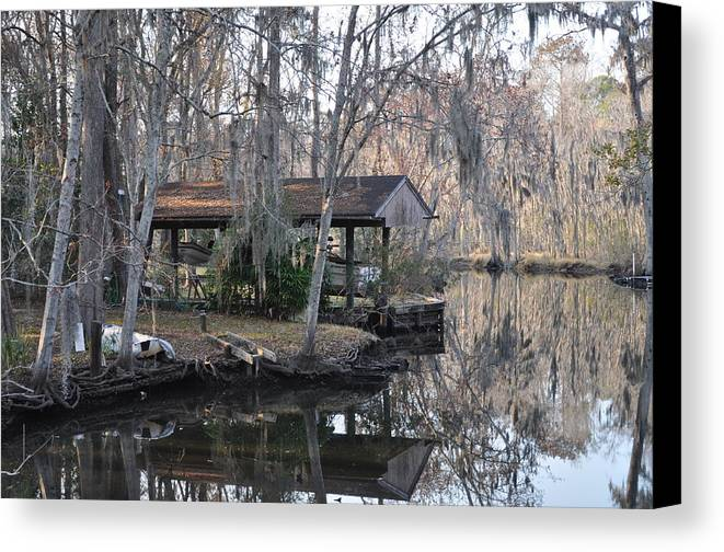 Boats Canvas Print featuring the photograph The Boathouse by Tiffney Heaning