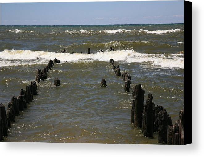 Sand Surf Canvas Print featuring the photograph The Last Wooden Pier by Robert Pearson