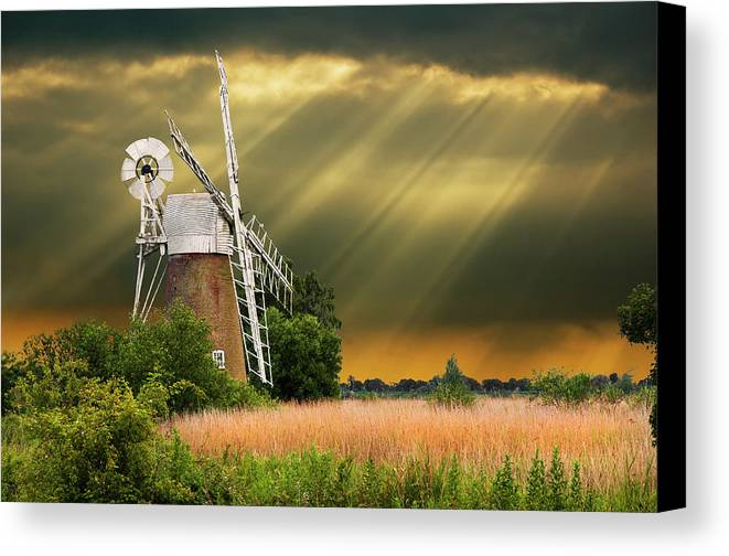 Windmill Canvas Print featuring the photograph The Mill On The Marsh by Meirion Matthias