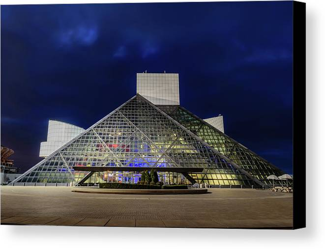 And Canvas Print featuring the photograph The Rock And Roll Hall Of Fame At Dusk by Cityscape Photography