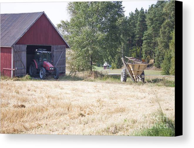 Tractor Canvas Print featuring the photograph Tractor At A Wheat Field by D R
