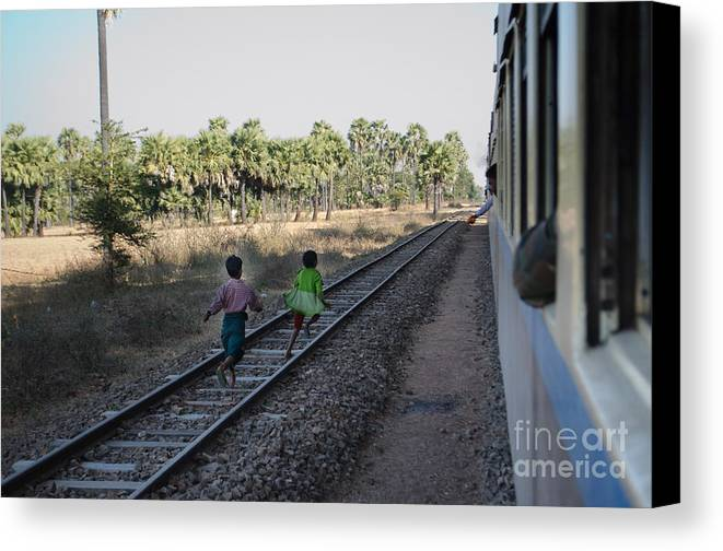 Asia Canvas Print featuring the photograph Two Kids Run Along And Follow Train In Burma by Jason Rosette
