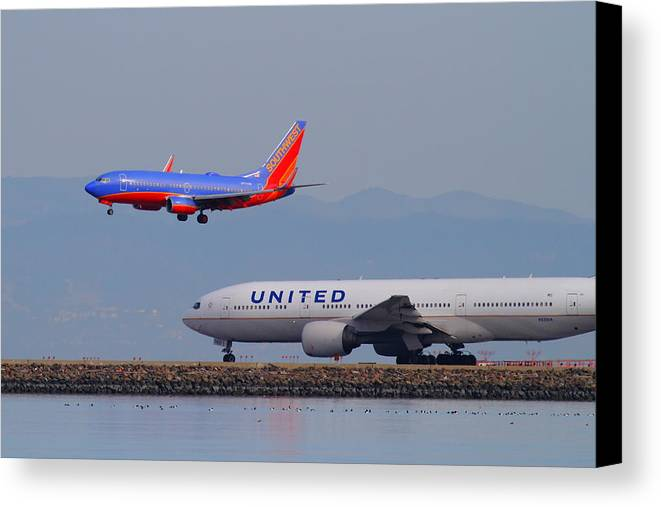 Southwest Canvas Print featuring the photograph United Airlines And Southwest Airlines Jet Airplane At San Francisco International Airport Sfo.12087 by Wingsdomain Art and Photography