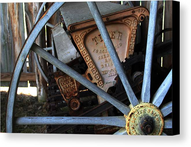 Wagon Canvas Print featuring the photograph Wagon Wheel And Grass Seeder by Joanne Coyle