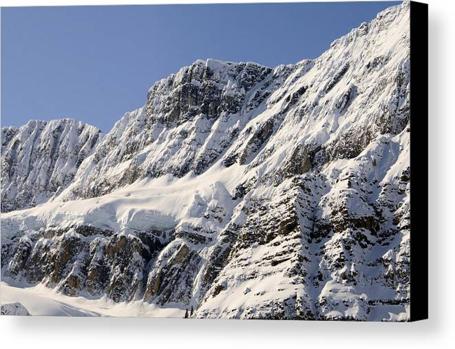 Snow Canvas Print featuring the photograph Winter Rockies by Tiffany Vest