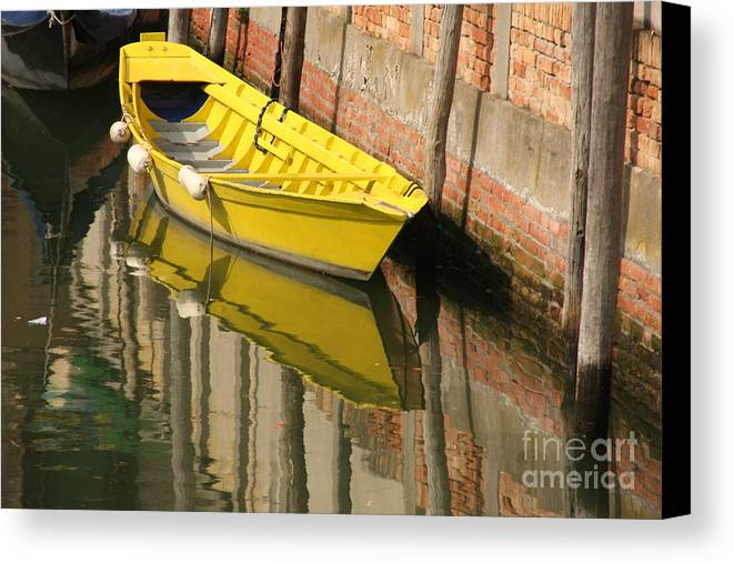 Venice Canvas Print featuring the photograph Yellow Boat In Venice by Michael Henderson