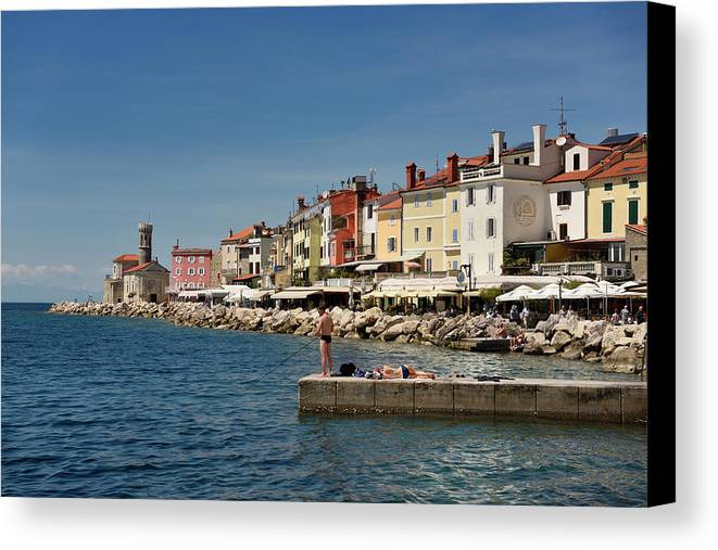 Young Canvas Print featuring the photograph Young Couple Fishing Reading Sunbathing On Dock At Piran Sloveni by Reimar Gaertner