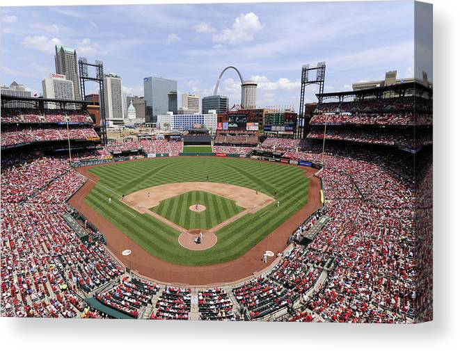 St. Louis Cardinals Canvas Print featuring the photograph Cincinnati Reds V. St. Louis Cardinals by Ron Vesely