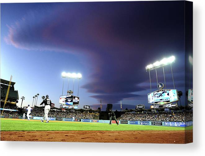 Ball Canvas Print featuring the photograph Colorado Rockies V Los Angeles Dodgers by Harry How