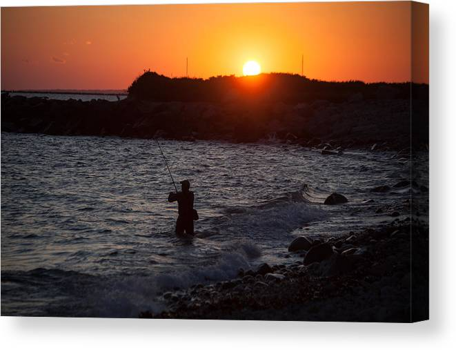 Fishing At Sunset Canvas Print featuring the photograph Fishing At Sunset by Karol Livote
