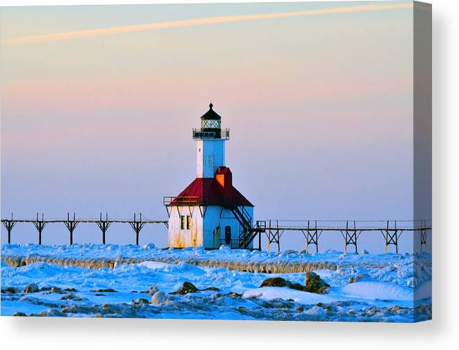 Lighthouse Canvas Print featuring the photograph Lighthouse On Ice by Rick Jackson