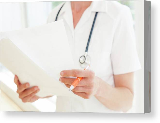 Indoors Canvas Print featuring the photograph Nurse With Paperwork by Ian Hooton/science Photo Library