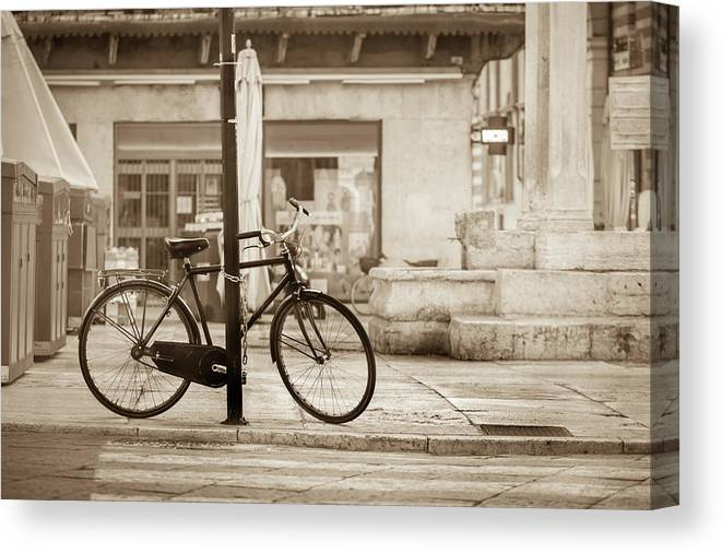 Residential District Canvas Print featuring the photograph Old Bicycle Parking by Deimagine
