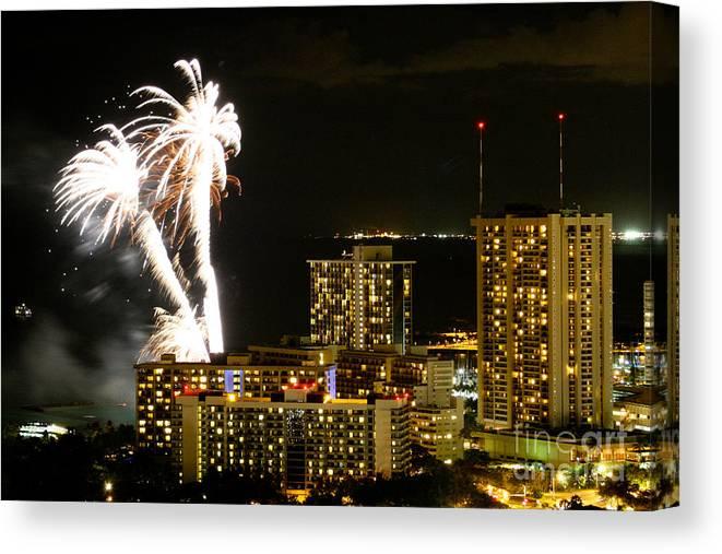 Waikiki Canvas Print featuring the photograph Waikiki Fireworks by Laarni Montano