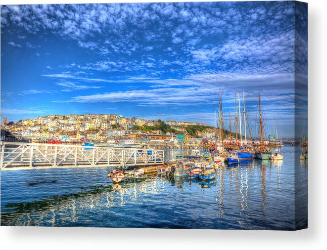 Uk Canvas Print featuring the photograph White Jetty Walkway Leading To Boats And Yachts In A Marina With Blue Sky And Reflections by Michael Charles