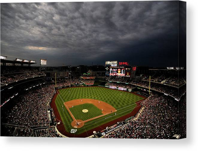 American League Baseball Canvas Print featuring the photograph Cincinnati Reds V Washington Nationals by Patrick Smith