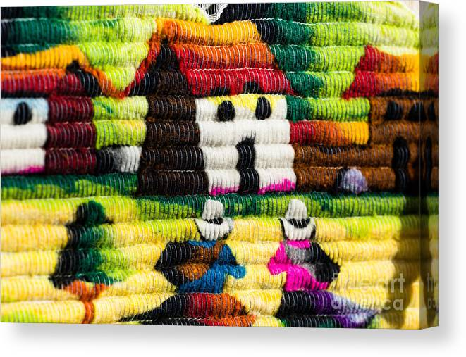 Alpaca Canvas Print featuring the photograph Colorful Fabric At Market In Peru by Mariusz Prusaczyk