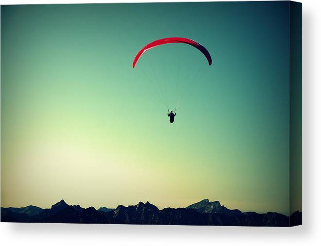 Paraglider Canvas Print featuring the photograph Paraglider by Chevy Fleet