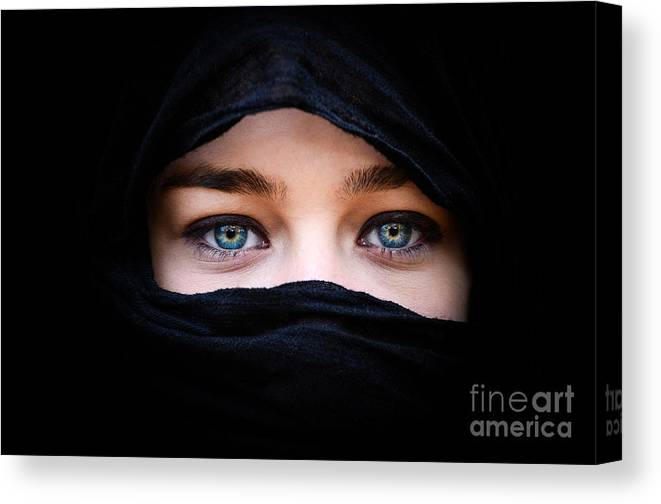 Allah Canvas Print featuring the photograph Portrait Of Beautiful Woman With Blue Eyes Wearing Black Scarf by Aleksandar Mijatovic