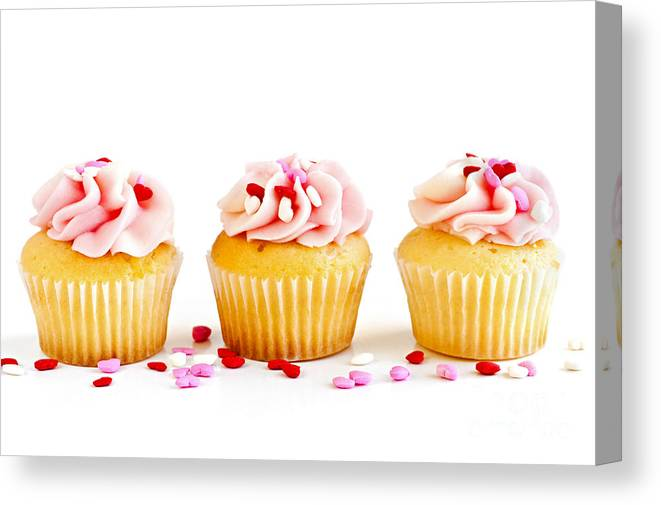 Row Canvas Print featuring the photograph Cupcakes by Elena Elisseeva