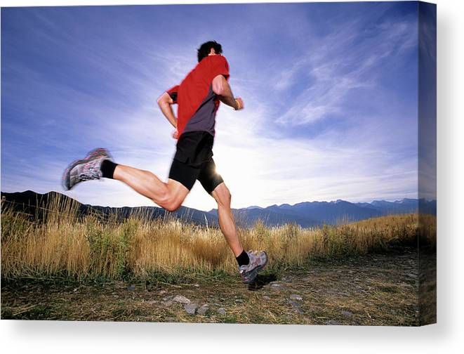 Action Canvas Print featuring the photograph A Man Trail Runs In Salt Lake City by Scott Markewitz