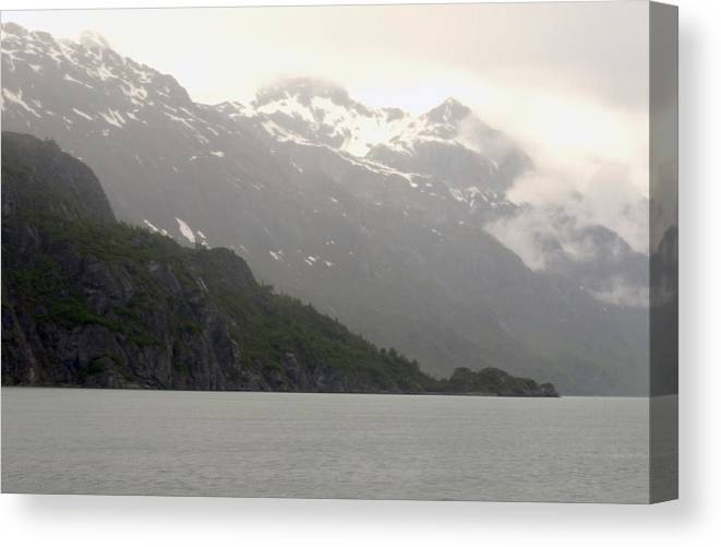Snow Capped Mountains Canvas Print featuring the photograph A Placid Alaska by Tom Wurl