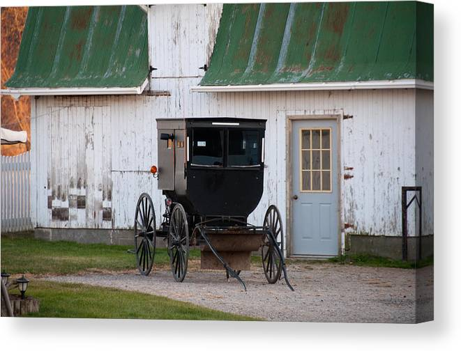 Amish Buggy Canvas Print featuring the photograph Amish Buggy White Barn by David Arment