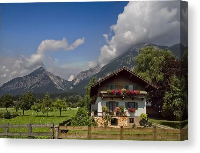 Austria Canvas Print featuring the photograph Austrian Cottage by Debra and Dave Vanderlaan