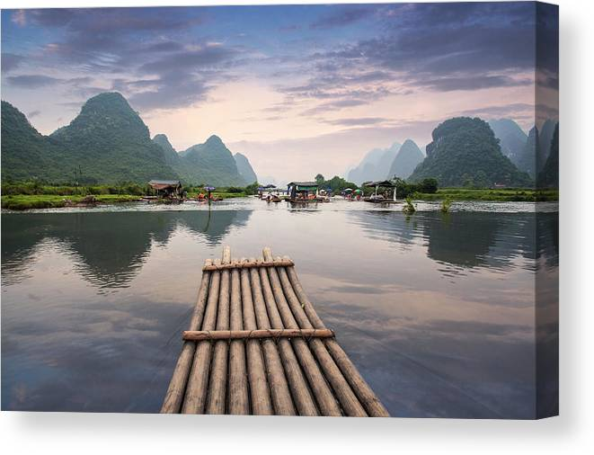 Tranquility Canvas Print featuring the photograph Bamboo Raft On Yulong River by Ray Wise