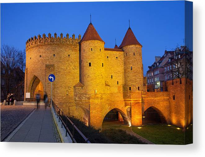 Warsaw Canvas Print featuring the photograph Barbican At Night In The Old Town Of Warsaw by Artur Bogacki