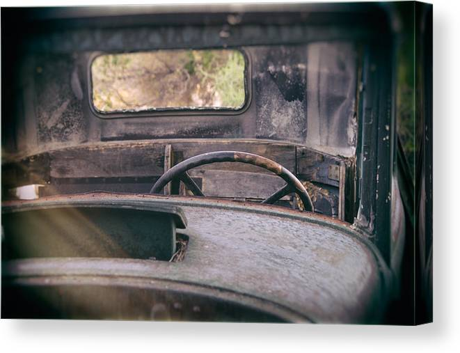 Abandoned Canvas Print featuring the photograph Behind The Wheel by Peter Tellone