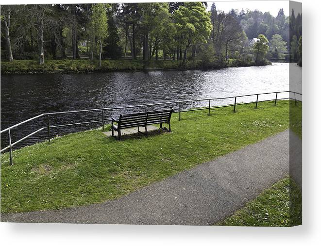 Bench Canvas Print featuring the photograph Bench On Shore Of River Ness In Inverness by Ashish Agarwal
