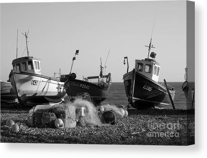 Fishing Boat Boats Seaside Retro Vintage Maritime Ships Beer Devon Coast Sea Shadows Shadow Beach Beached South West Black White Monochrome Surreal Three British English England Great Britain Wooden Coastal Vessel Vessels Ocean Landscape Seascape Art Artistic Arty Traditional Low Tide Scene Eerie Drama Dramatic Striking Classic Calm Moody Net Nets Europe European Outdoors Detail Town Uk   Canvas Print featuring the photograph Boats On Beer Beach by Hugh Reynolds