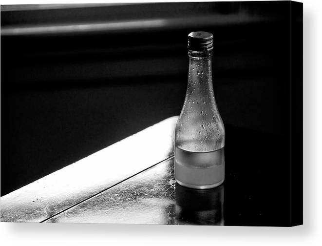 Oil Canvas Print featuring the photograph Bottle Near Window by Guillermo Hakim