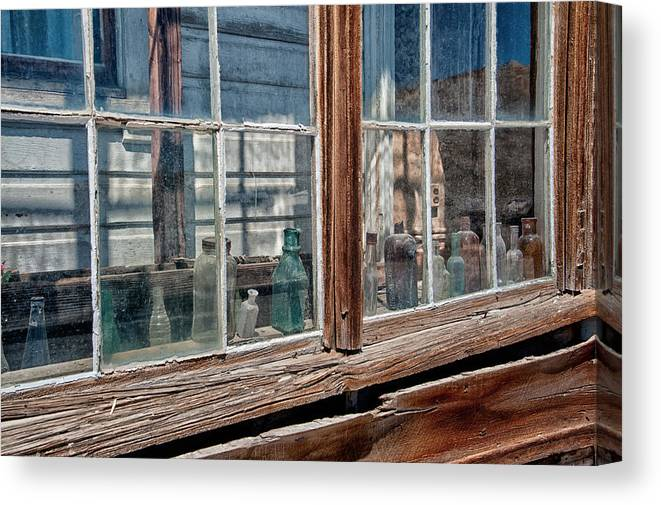 Glass Canvas Print featuring the photograph Bottles In The Window by Cat Connor