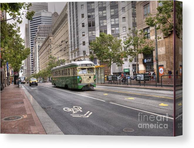 Market Street Canvas Print featuring the photograph Busing Down Market by David Bearden