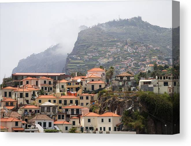 Horizontal Mist Misty Cable Car Outdoor Tourist Tours View Spectacular Vacation Holiday Atlantic Ocean Portuguese Sea Cliff Steep Escarpment Look Out Point Panoramic Coast Coastline Waves Exterior Landscape Mountains Rocks Mountainous Calm Water Summer Seashore Color Color Daytime Outdoor Nobody Houses Red Roofs Village Hillside Slope Canvas Print featuring the photograph Cabo Girao Madeira Portugal by Jim Wallace
