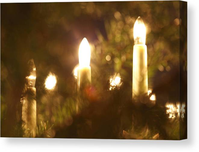 Blurred Canvas Print featuring the photograph Candles Seen Through A Fir Tree by Ulrich Kunst And Bettina Scheidulin